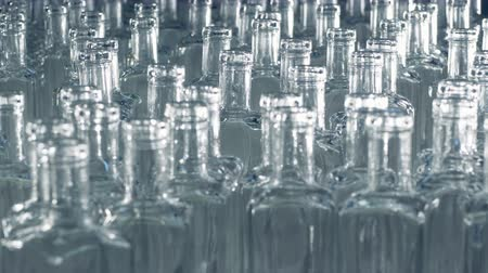 pushed : Plenty of fresh glass bottlings are being slightly pushed forwards or moved sideways Stock Footage
