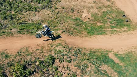 enduro : Motocross biker jumps, side view.