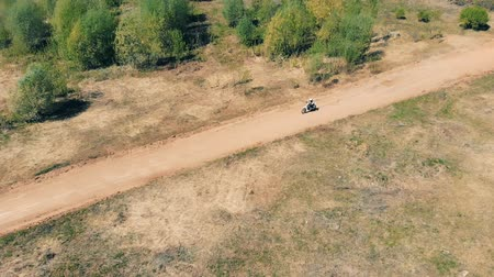 enduro : Motorcycle rider goes on a straight track, top view.