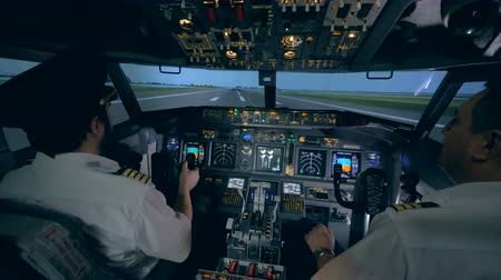 pulling off : Professional pilot is giving instructions to an amateur while taking off in a flight simulator