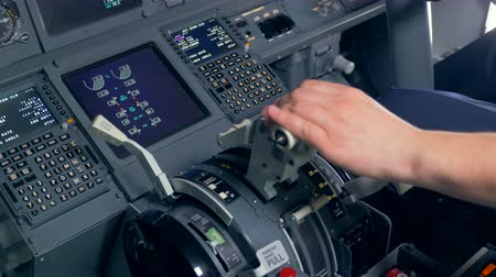functioning : Professional pilot is flying a plane by regulating a throttle lever and a control wheel