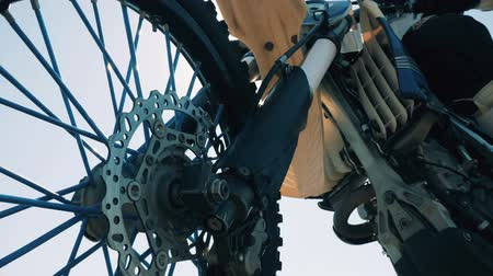 autobike : Close up of a wheel of an FMX motorbike Stock Footage
