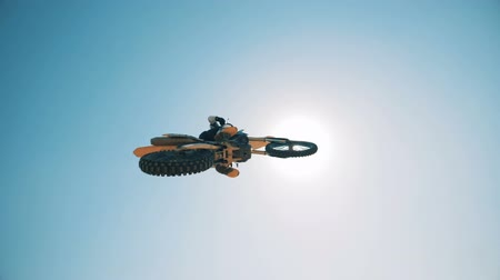 autobike : Panoramic view of the sky with a motorcyclist flying over it Stock Footage