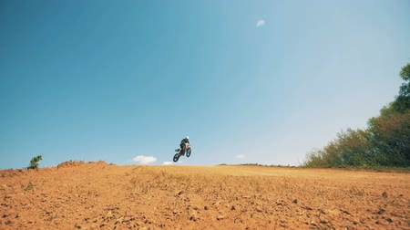 autobike : FMX racer is landing after performing a trick and keeps driving Stock Footage