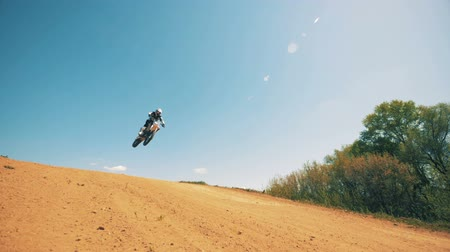 autobike : Motorcycler is performing a jumping trick on his sportbike