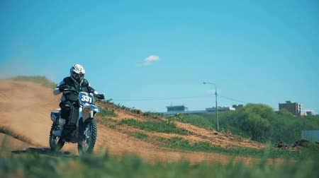 enduro : Sportbike with its pilot is riding down the hill