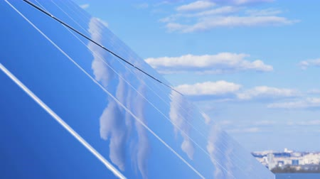 поколение : The sky is reflecting in a solar panel under right angle. Ecology Power Conservation Concept. Стоковые видеозаписи