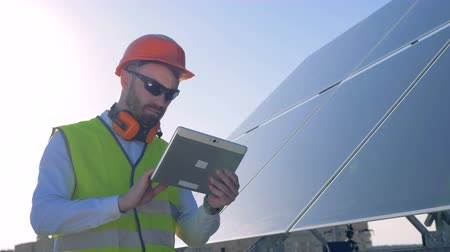modul : Expert is inspecting quality of a solar panels. Ecology Power Conservation Concept
