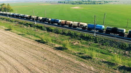 benzin : Lots of tank wagons with oil, gas, fuel on a railway, top view. Stok Video