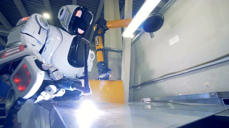fire arms : Human-like welding metal plate. 4K. Stock Footage