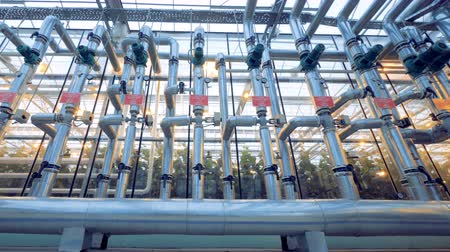 propagação : Wide angle view of a pipeline system in a glasshouse