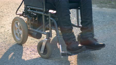 challenged : Close up of invalids legs in a wheelchair