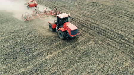fertilizing : The tractor moves across the field. Aerial, top view. Stock Footage