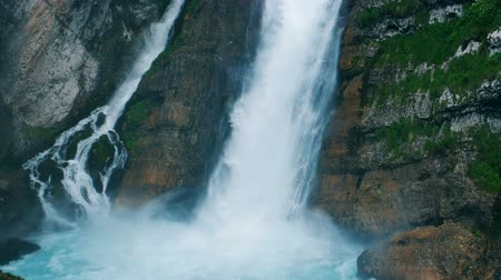 raging : Cascade water streams down. Roaring water is falling into a mountain brook. Stock Footage