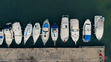 speedboats : Row of boats located along the pier on a view from above