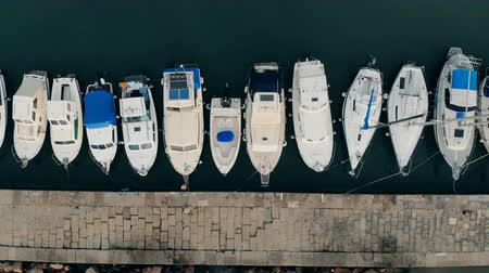 speedboats : Top view of a straight line of yachts moored to the docks