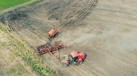 sowing : Tractor in a field. Aerial view. Healthy Food Production Concept.