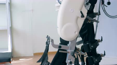 física : Disabled man is exercising on a walking simulation machine