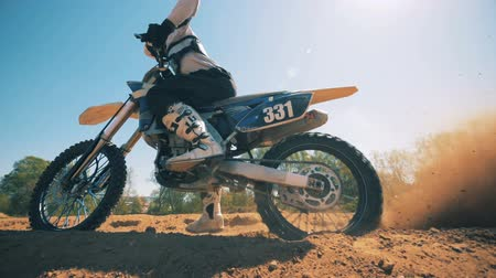 equipped : FMX racer starts moving on his motorcycle Stock Footage