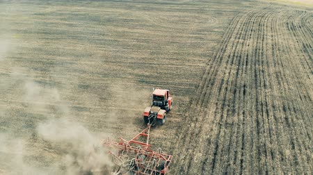 seeder : Sowing process performed by a field engine on a vast terrain Stock Footage