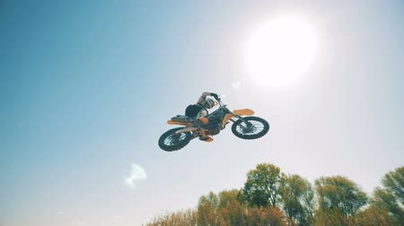 autobike : A leap of a motorcycles driver against the sky in the background