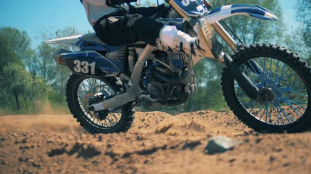 autobike : Motorbike is racing across sandy terrain in slow motion Stock Footage