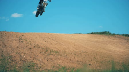 autobike : Slow motion jumping trick of an FMX racer