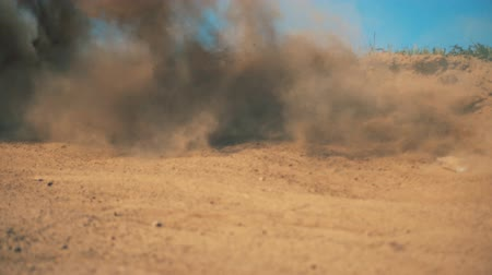 extreme close up : Clouds of dirt raised after high-speed passing of a sportbike Stock Footage