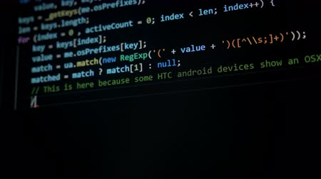 malware : A hacker writes computer code, close up.