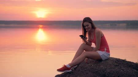 tropical insects : Female in a mosquitos cloud looks at her phone. 4K. Stock Footage