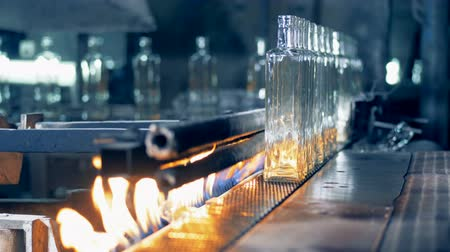 fire facilities : Factory equipment pasteurizes bottles, close up. Stock Footage