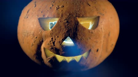 questão : Close of an illuminated halloween pumpkins face. Happy halloween pumpkin concept.