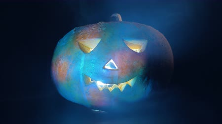 frightful : Halloween pumpkin illuminated from inside and outside. Halloween pumpkin in dark.