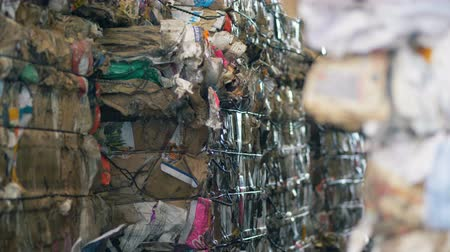 preslenmiş : Pressed garbage at a waste recycling plant, close up. Stok Video