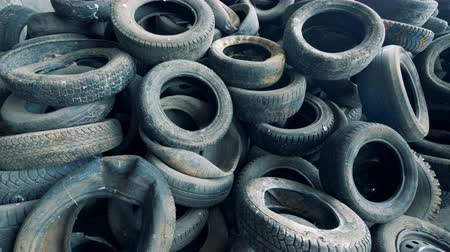 piled up : Lots of used tires, close up. Car tires are thrown away to the dump.