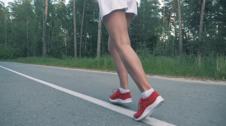 thighs : Healthy lifestyle concept. Slow motion footage of female jogging.