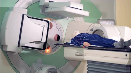 malignant cells : Hospital radiology room with a male patient undergoing radiotherapy