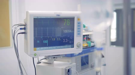 intensive care unit : Readings of vital signs on a medical monitor are changing Stock Footage