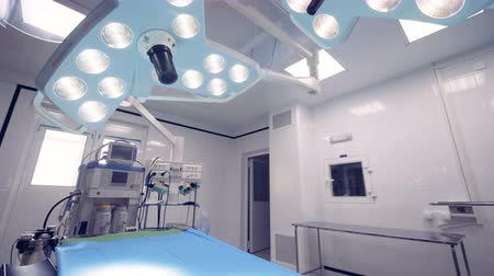 equipped : Equipped operating room with two surgical lamps and a table Stock Footage