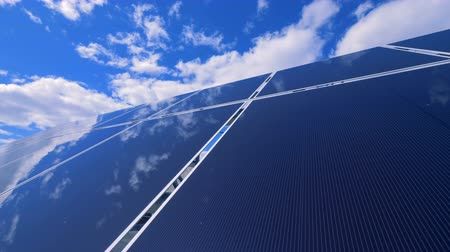 avançar : Specular surface of a solar panel is reflecting clean blue sky