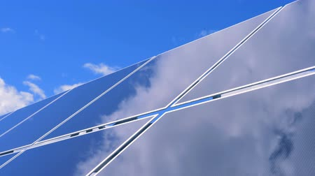 energetyka : Reflection of the cloudy blue sky on a smooth surface of a solar module
