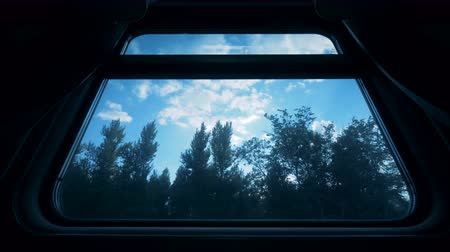 двухместная карета : Landscape seen from a window of moving a trains coach. Travelling by train concept.