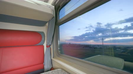 двухместная карета : Twilight scenery filmed through the window of a coupe coach. Speed train interior.