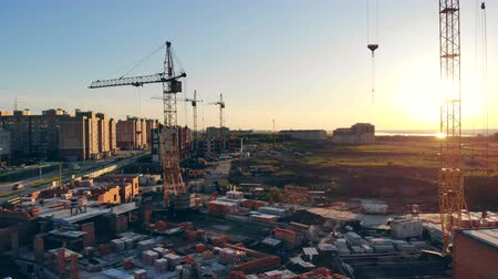 корпус : Several lifting cranes are standing in a construction site. View from above. Стоковые видеозаписи