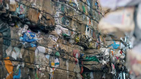 collected : Blocks of rubbish contained in a recycling facility. Waste recycling plant.