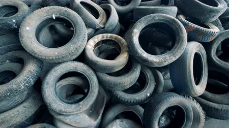 biodegradable : Plenty of useless wasted machinery tires piled up in a top view