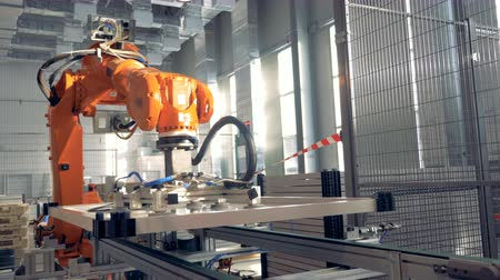 Robotic Arm works at modern factory facility. 影像素材