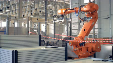 Modern industrial factory concept. Robotic arm packing products.