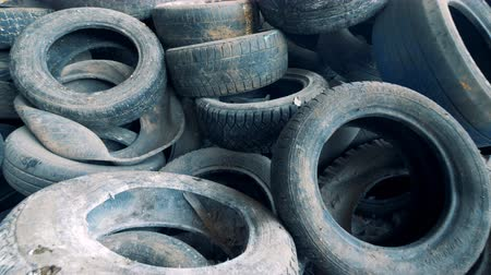 wasted : Many useless wasted machinery tires piled up in a top view Stock Footage