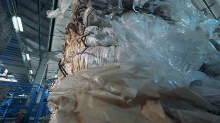 reutilizável : A pile of polyethylene rubbishpacked into piles ready for recycle.